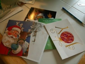 recycle your old christmas cards into small boxes