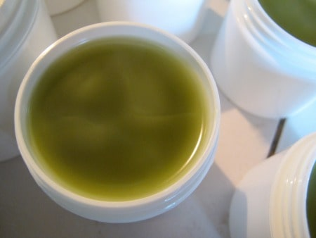 jewelweed salve in a white tub, setting up and cooling