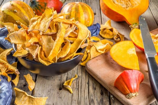 bowl of dried squash chips and cut up winter squash