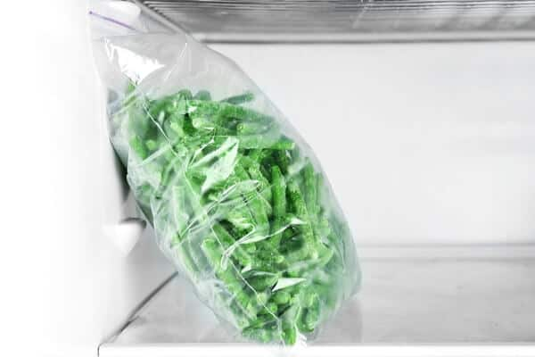 bag of frozen green beans in the freezer