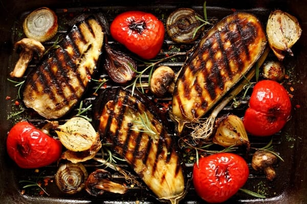 grilled eggplant steaks with tomatoes, onions and mushrooms