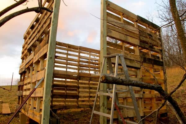 2 layers of pallets to make pallet barn walls