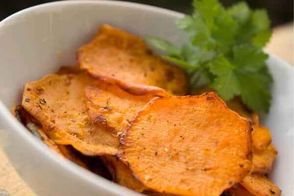 sweet potato chips with seasoning in a bowl
